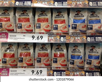 MELAKA, MALAYSIA - OCTOBER 12, 2018: Rows of Quaker outs instant oatmeal on shop shelf