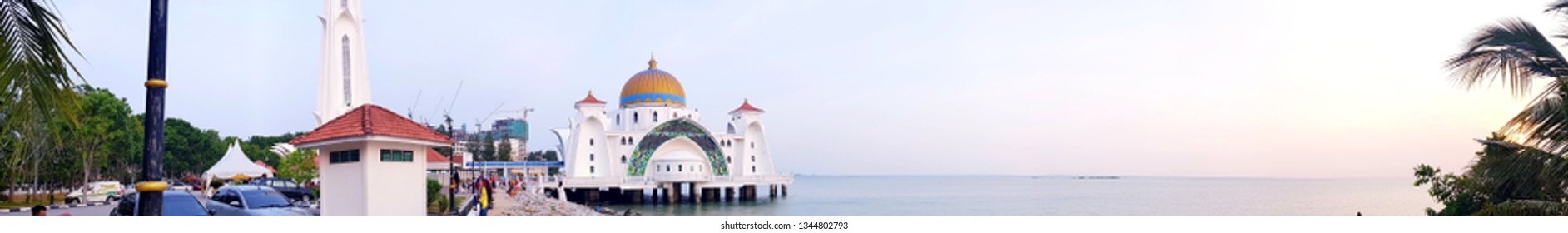 The Melaka Straits Mosque (Masjid Selat Melaka), Melaka, Malaysia - Jan 24th, 2019 - is a mosque located on the man-made Malacca Island in Malacca City, Malacca, Malaysia