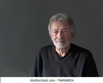 Melancholic man with beard against a dark background