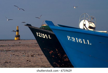 Melancholic picture of fishingboats waiting for next tide.