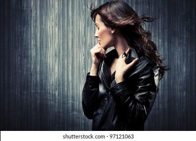 melancholy adult woman in black leather  jacket profile portrait