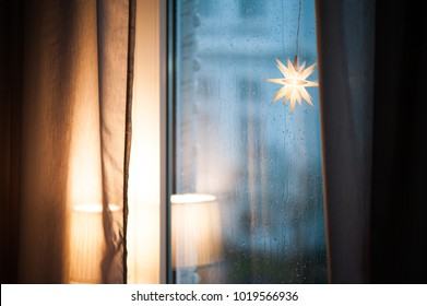 Melancholy and longing at the rainy window. A star is shining