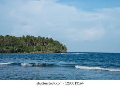 Melanesia, Papua New Guinea, Bismarck Sea, Tuam Island. Scenic Pacific Ocean coastal island view.