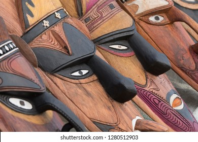 Melanesia, Papua New Guinea, Sepik River area, Murik Lakes, Karau Village. Traditional carved wooden masks that the area is famous for.