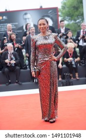 Melanie Brown  walks the red carpet ahead of the Opening Ceremony  during the 76th Venice Film Festival at Sala Grande on August 28, 2019 in Venice, Italy.