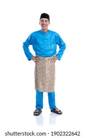 melayu male with satin clothes smiling his hand on hips over white background