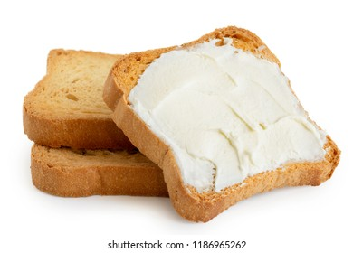 Melba toast with cream cheese lying on two plain toasts isolated on white.