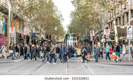 Melbourn Australia  03.10.2019 People cross the road