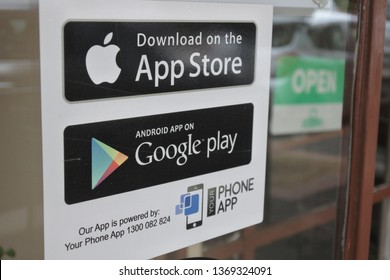 MELBOURNE - APR 01 2019:App Store and Google Play stickers on a shop door, a digital distribution platforms for Apple and Android operating systems allowing users to browse and download applications.
