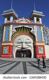 MELBOURNE - APR 02 2019:People outside the closed gate of the Luna Park, an historic amusement park located on the foreshore of Port Phillip Bay in St Kilda, Melbourne, Victoria Australia.