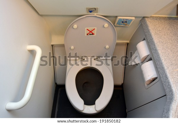 MELBOURNE  - APRIL 15 2014:Aircraft lavatory toilets aboard a jetliner airplane.On board airline carriers, The standard ratio of lavatories to passengers is 1 lavatory for every 50 passengers.