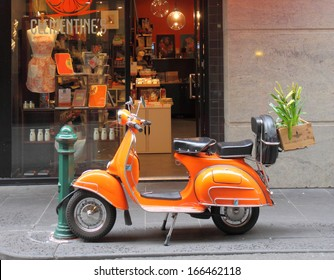 MELBOURNE - August 3: Orange Vespa parked on Degraves Street Melbourne downtown - August 3,2013 in Melbourne Australia.