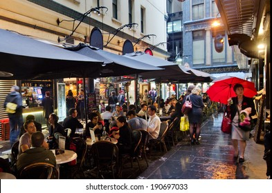 MELBOURNE, AUS - APR 10 2014:Crowd of people dining in Degraves Street, one of Melbourne's finest Laneway environments. Full of bars,restaurants, cafe and boutique shopping.