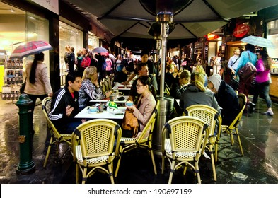MELBOURNE, AUS - APR 10 2014:Crowd of people dining in cafe restaurants on Degraves Street, one of Melbourne's finest Laneway environments. Full of bars,restaurants, cafe and boutique shopping.