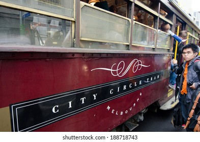 MELBOURNE, AUS - APR 10 2014:Passengers on the W class tram in City Circle service.It's a zero-fare tram  aimed mainly for tourists running around the central business district of Melbourne,Australia.