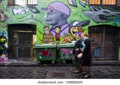 MELBOURNE, AUS - APR 10 2014:Pedestrian walks in Hosier Lane.Hosier lane is a much celebrated landmark in Melbourne mainly due to its sophisticated graffiti urban art.
