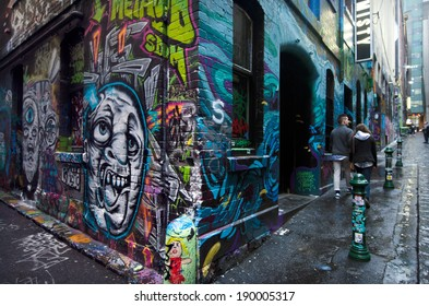 MELBOURNE, AUS - APR 10 2014:Visitors at Hosier Lane.Hosier lane is a much celebrated landmark in Melbourne mainly due to its sophisticated graffiti urban art.