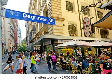 MELBOURNE, AUS - APR 11 2014:Traffic on Degraves Street, one of Melbourne's finest Laneway environments. Full of bars,restaurants, cafe and boutique shopping.