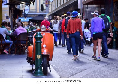 MELBOURNE, AUS - APR 13 2014:Pedestrians Traffic on Degraves Street, one of Melbourne's finest Laneway environments. Full of bars,restaurants, cafe and boutique shopping.