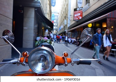 MELBOURNE, AUS - APR 13 2014:Tourists visiting in Degraves Street, one of Melbourne's finest Laneway environments. Full of bars, restaurants, cafes and boutique shopping.