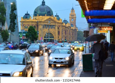 MELBOURNE, AUS - APR 1O 2014:Traffic outside Flinders Street Station.It was the first railway station in an Australian city and the world's busiest passenger station in the late 1920s.