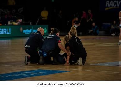 MELBOURNE, AUSTRALIA -05 MAY, 2019: Suncorp Super Netball, Melbourne 2019 Melbourne Vixens VS Giants Netball. Medical staff attending to an injured cheerleader