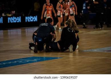 MELBOURNE, AUSTRALIA -05 MAY, 2019: Suncorp Super Netball, Melbourne 2019 Melbourne Vixens VS Giants Netball. Medical staff attending to an injured cheerleader.