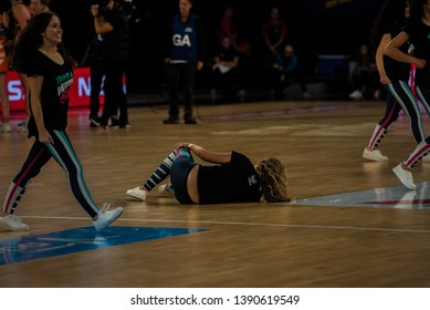 MELBOURNE, AUSTRALIA -05 MAY, 2019: Suncorp Super Netball, Melbourne 2019 Melbourne Vixens VS Giants Netball. Cheerleader down injuring a knee.