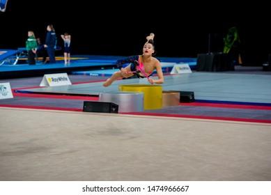 MELBOURNE, AUSTRALIA - 1 JUNE, 2019: Australian Gymnastics Championships, Melbourne Arena, MELBOURNE 2019.  Rhythmic Gymnastics. Aya Tanaka-Probert (NZL) - clubs routine, butterfly leap.