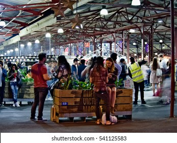 Melbourne, Australia - 21 December 2016: Shoppers was buzzing and enjoying last Summer Night Market before Christmas at Queen Victoria Markets.