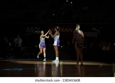 MELBOURNE, AUSTRALIA -27 APRIL, 2019: Suncorp Super Netball, Melbourne 2019 Melbourne Vixens VS Queensland Firebirds. Players entering the field. Queensland Firebirds Caitlyn Nevins and Romelda Aiken
