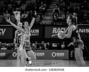 MELBOURNE, AUSTRALIA -27 APRIL, 2019: Suncorp Super Netball, Melbourne 2019 Melbourne Vixens VS Queensland Firebirds. Q1. Watson with a ball in black and white.