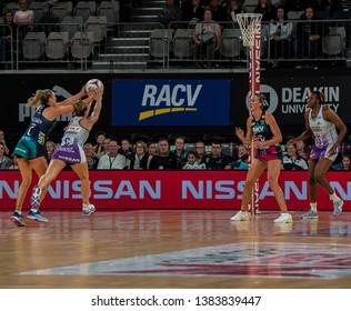 MELBOURNE, AUSTRALIA -27 APRIL, 2019: Suncorp Super Netball, Melbourne 2019 Melbourne Vixens VS Queensland Firebirds. Q1. Cassidy Vs Moloney challenge for the ball.
