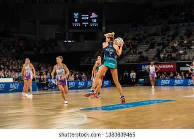 MELBOURNE, AUSTRALIA -27 APRIL, 2019: Suncorp Super Netball, Melbourne 2019 Melbourne Vixens VS Queensland Firebirds. Q1. Moloney up in the air with a ball.