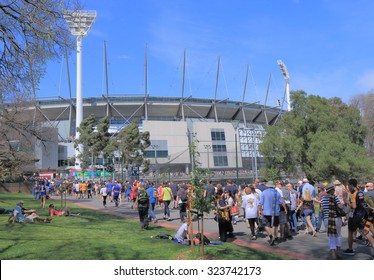 MELBOURNE AUSTRALIA - 3 OCTOBER, 2015. Unidentified people visit MCG for AFL ground final game. Melbourne Cricket Ground also know as MCG hosts AFL Ground final game.