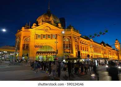 MELBOURNE, AUSTRALIA -7 DEC 2016- Night view of the Flinders Street railway station, the largest train station serving the Melbourne area.The landmark Victorian building was built in 1909.