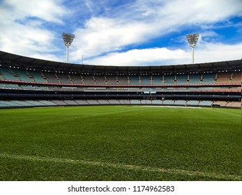 Melbourne, Australia - 7th September, 2017: View of the lush green fields, colossal stands and tall floodlights of the Melbourne Cricket Ground (MCG) with blue sky as background