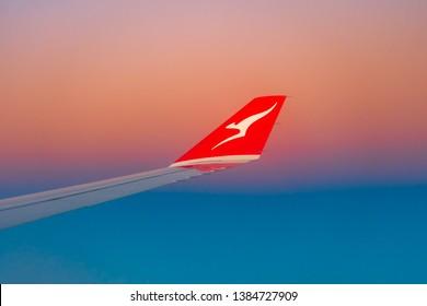 Melbourne, Australia - Apr 25, 2019: Qantas plane wing at sunrise