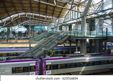 Melbourne, Australia - April 1, 2017: Escalators and stairs leading down to platforms at Southern Cross Railway station in Melbourne CBD