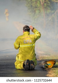 Melbourne, Australia - April 13, 2018: Exhausted Fire fighter at a bush fire in an suburban area of Knox City in Melbourne east.