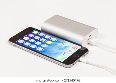 Melbourne, Australia - April 22, 2015: Charging an iPhone 6 with portable USB power bank