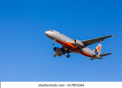 Melbourne, Australia - April 26, 2016: View of Jetstar aircraft approaching to landing at Melbourne Airport during daytime. Jetstar is Australian low-cost airline and owned by the Qantas Group.