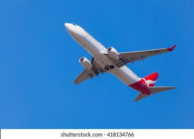 Melbourne, Australia - April 26, 2016: View of Qantas aircraft approaching to landing at Melbourne Airport during daytime. Qantas is Australia's largest domestic and international airline.