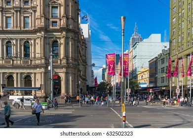 Melbourne, Australia - April 4, 2017: Shopping mall on Bourke street with HM store and crowds of people in the distance