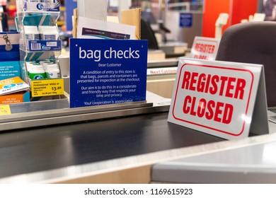 Melbourne, Australia - Aug 22, 2018: Checkout counter closed. Bag checks reminder displayed in ALDI supermarket.