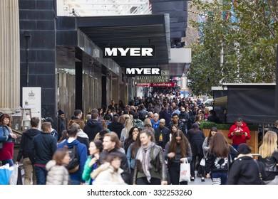 Melbourne, Australia - Aug 8, 2015: People walking along a busy street in downtown Melbourne, Australia
