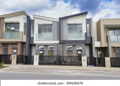 Melbourne, Australia - August 12, 2015: Newly built contemporary townhouses in Melbourne during daytime.