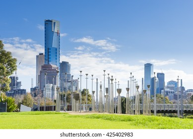 Melbourne, Australia - August 15, 2015: View of Birrarung Marr Park featuring the Federation Bells, an installation art on Yarra River's north bank with cityscape in the background in Melbourne.