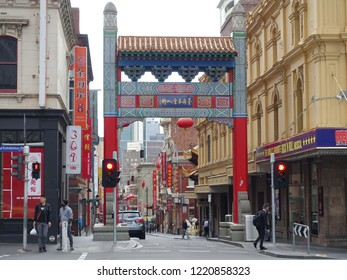 Melbourne, Australia - August 15, 2018: People gather by the Chinatown gate in the city centre.