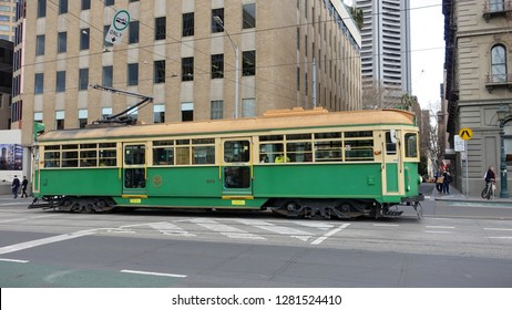 Melbourne, Australia - August 15, 2018: A tram transports passenger on a city centre street.
